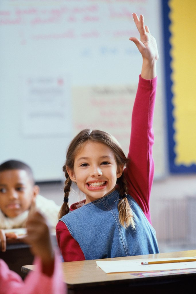 Stock Photo: 1574R-08429A Portrait of a girl raising her hand in class