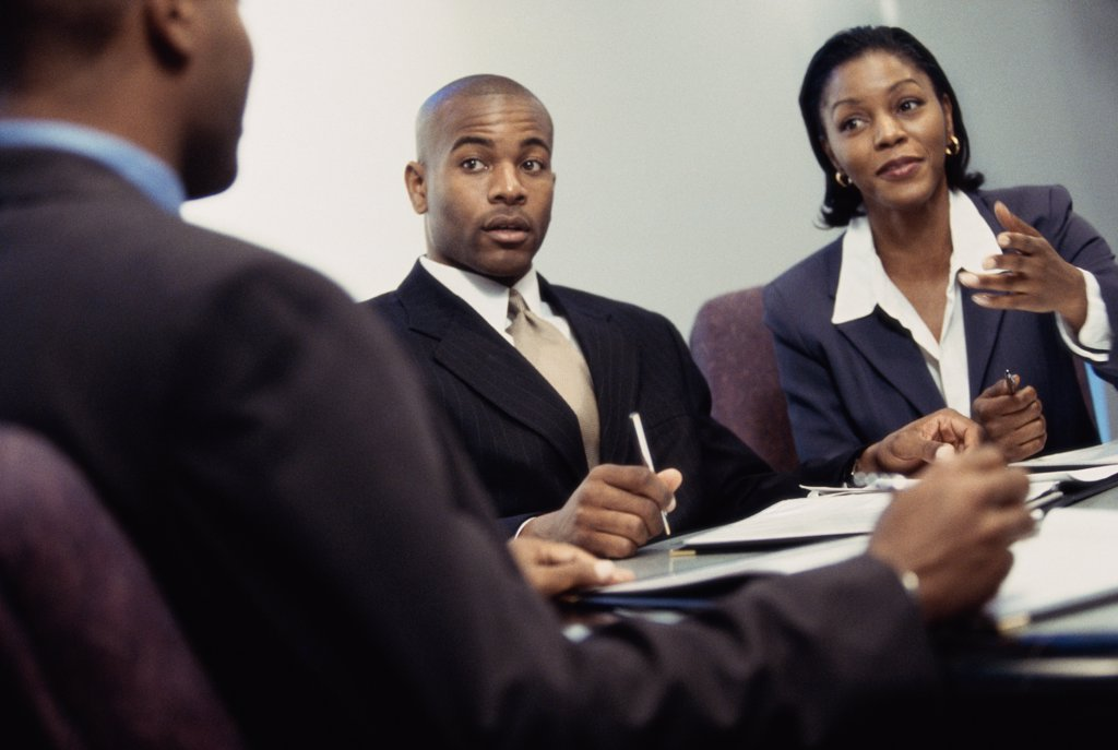 Stock Photo: 1574R-0882 Business executives discussing in an office