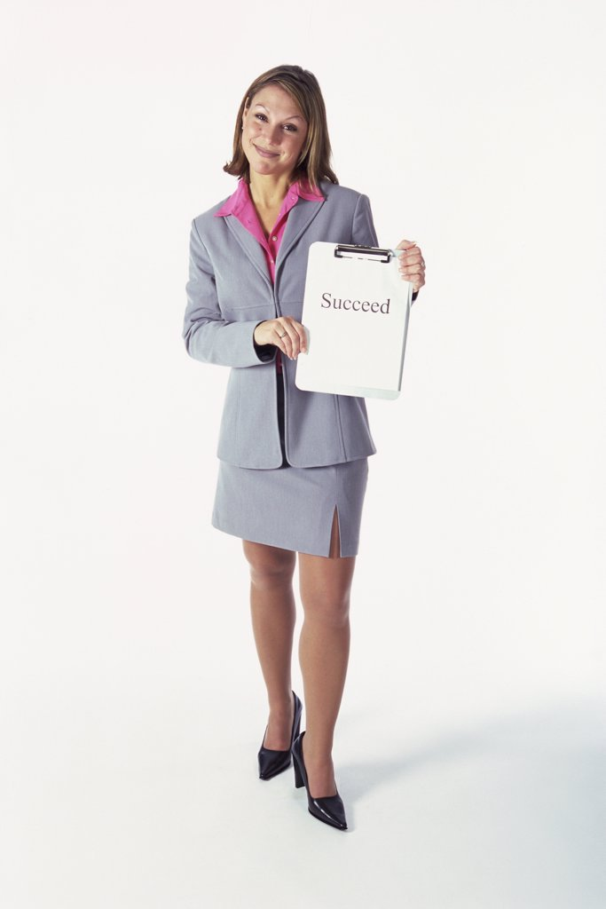 Portrait of a businesswoman holding a clipboard : Stock Photo
