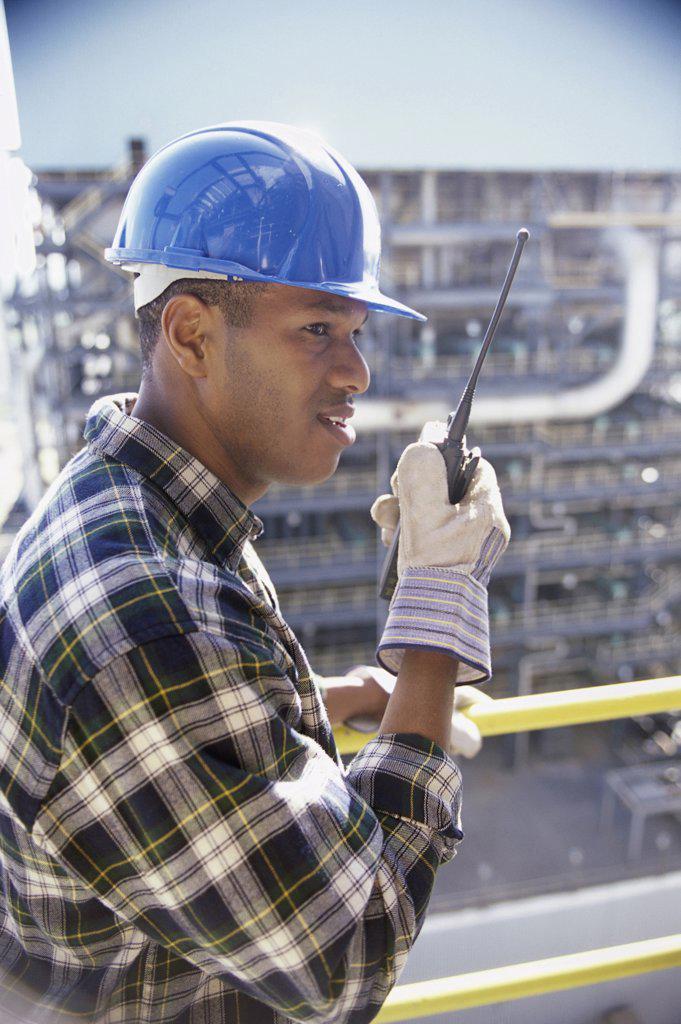 Foreman talking on a walkie-talkie : Stock Photo