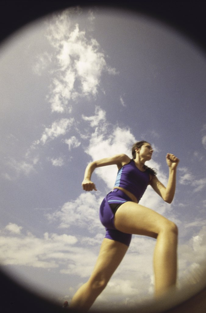Stock Photo: 1574R-09096 Low angle view of a young woman running