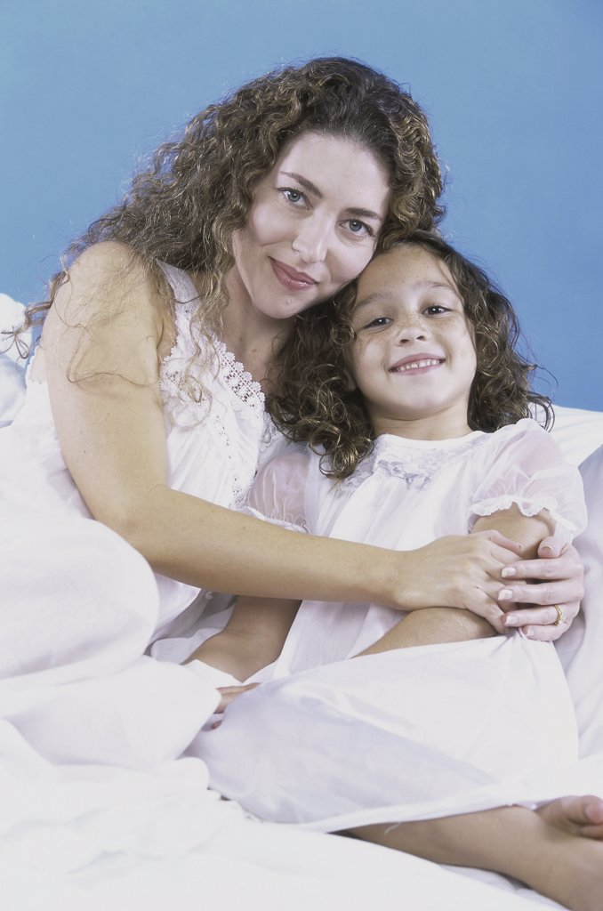 Portrait of a mother holding her daughter : Stock Photo