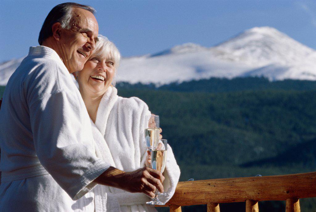 Senior couple holding glasses of champagne : Stock Photo