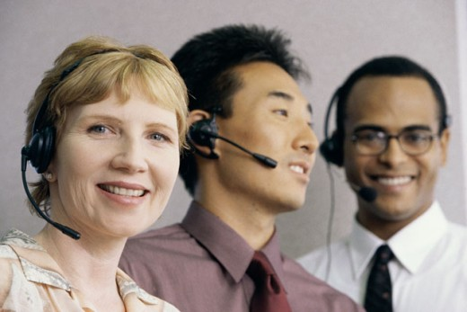 Stock Photo: 1574R-09469A Three customer service representatives wearing headsets smiling