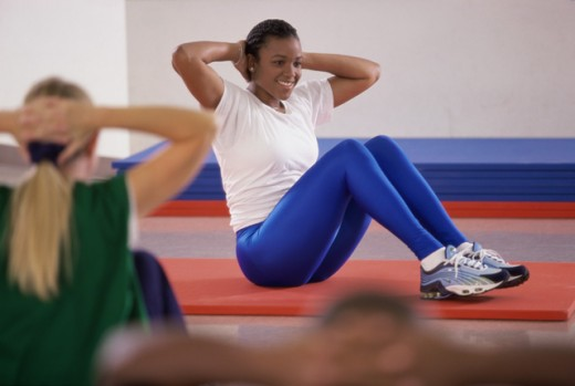 Stock Photo: 1574R-09510 Woman exercising on the floor