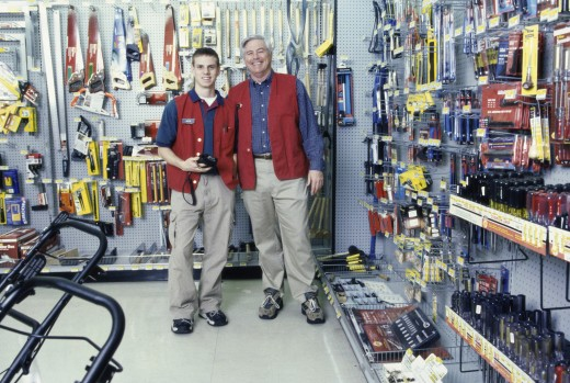Portrait of two male clerks in a hardware store : Stock Photo