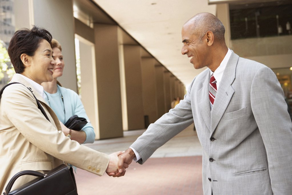 Stock Photo: 1574R-20164 Close-up of a businessman and a businesswoman shaking hands