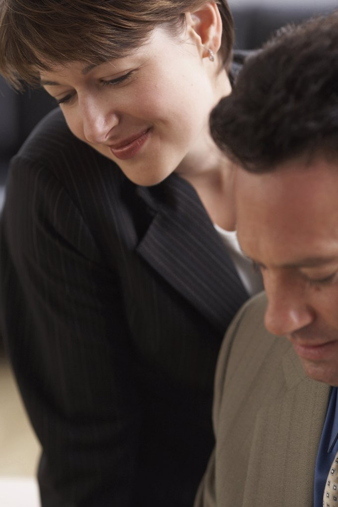Close-up of a businessman with a businesswoman : Stock Photo