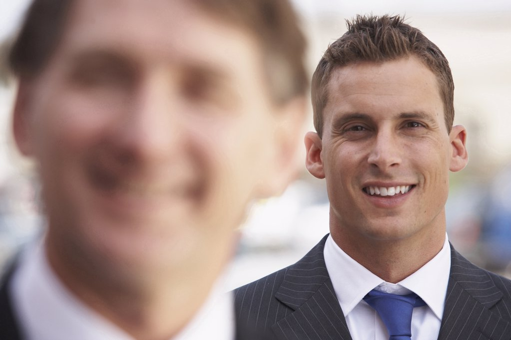 Close-up of two businessmen smiling : Stock Photo
