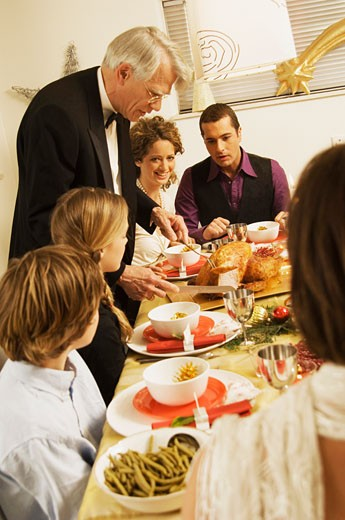 Stock Photo: 1574R-21148 Family at a dining table