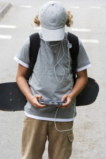 Close-up of a boy playing a video game : Stock Photo