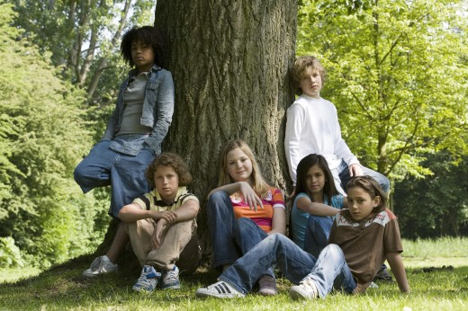 Group of children resting in a park : Stock Photo