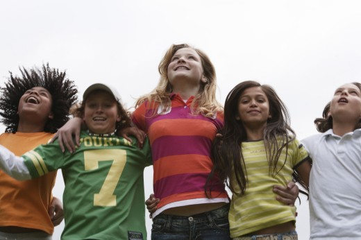 Stock Photo: 1574R-21206 Low angle view of five children standing side by side