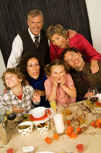Family making funny faces at a Christmas party : Stock Photo
