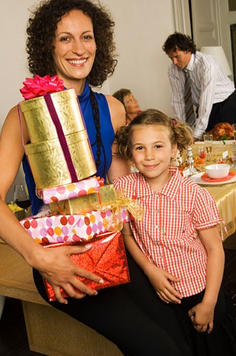 Portrait of a mid adult woman smiling with her daughter : Stock Photo