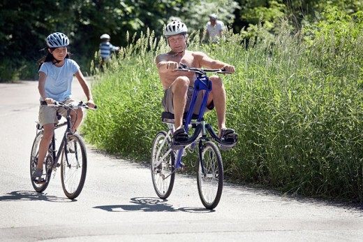 Stock Photo: 1574R-21308 Mature man and his daughter cycling