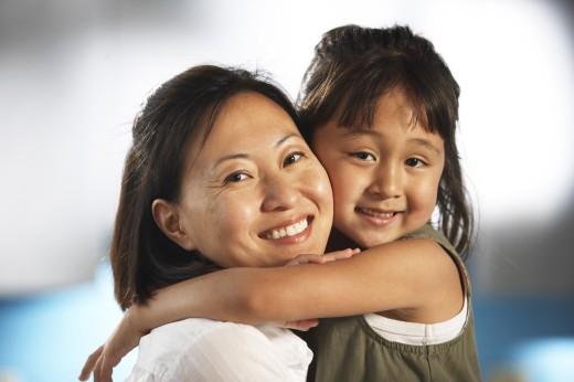 Stock Photo: 1574R-21333 Portrait of a mid adult woman hugging her daughter