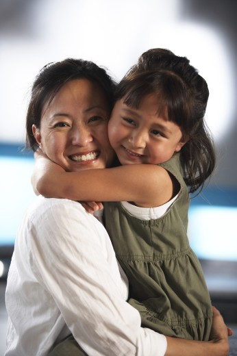 Stock Photo: 1574R-21334 Portrait of a mid adult woman hugging her daughter