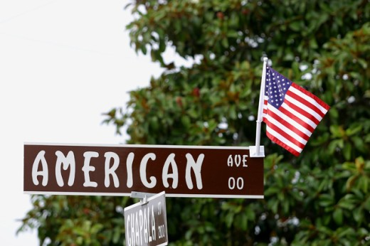 Stock Photo: 1574R-21768 Flag of the United States of America on a sign