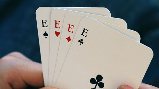 Stock Photo: 1574R-22347 Person's hand holding playing cards