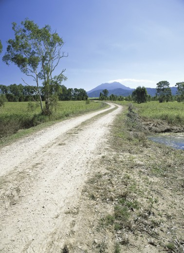 Stock Photo: 1574R-22639 Dirt road passing through the countryside, Australia