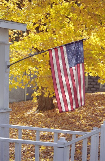 Stock Photo: 1574R-22747 Flag of the United States of America on a front porch
