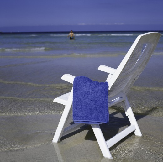 Stock Photo: 1574R-22980 Towel on a deck chair at the beach