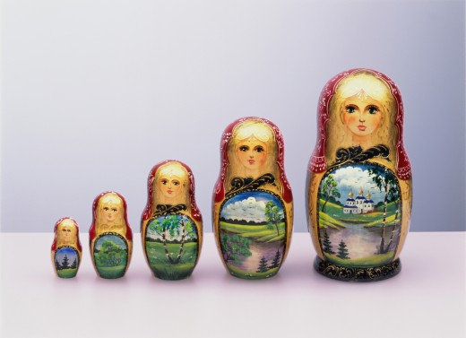 Row of five Russian dolls : Stock Photo