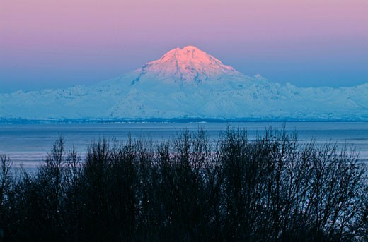 Sea in front of a volcanic mountain, Mount Redoubt, Cook Inlet, Alaska, USA : Stock Photo