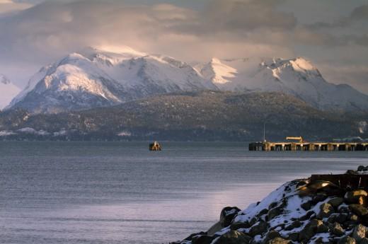 Sea near snowcapped mountains, Cook Inlet, Homer, Alaska, USA : Stock Photo