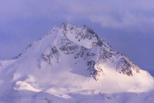 Stock Photo: 1574R-23493 Clouds over a snow covered mountain, Kenai Peninsula, Alaska, USA