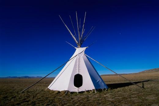 Stock Photo: 1574R-23679 Teepee on a landscape, Ulm Pishkun State Park, Montana, USA