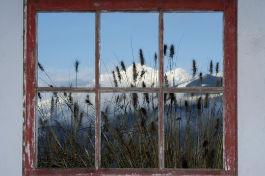 Snowcapped mountains viewed through a window : Stock Photo