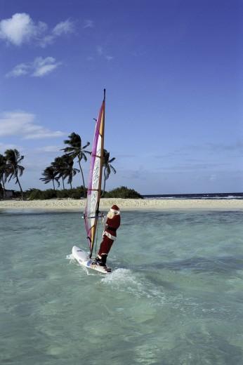 Stock Photo: 1574R-24685 Santa Claus windsurfing