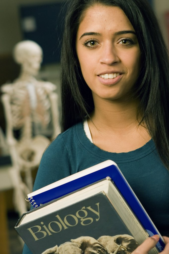 Stock Photo: 1574R-25391 Portrait of a student holding books