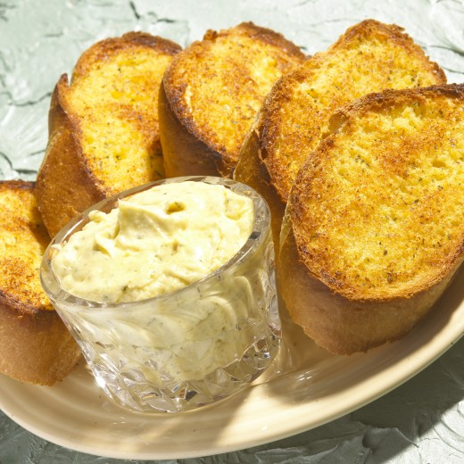 Stock Photo: 1574R-25869 Close-up of garlic bread with a bowl of dip on a plate