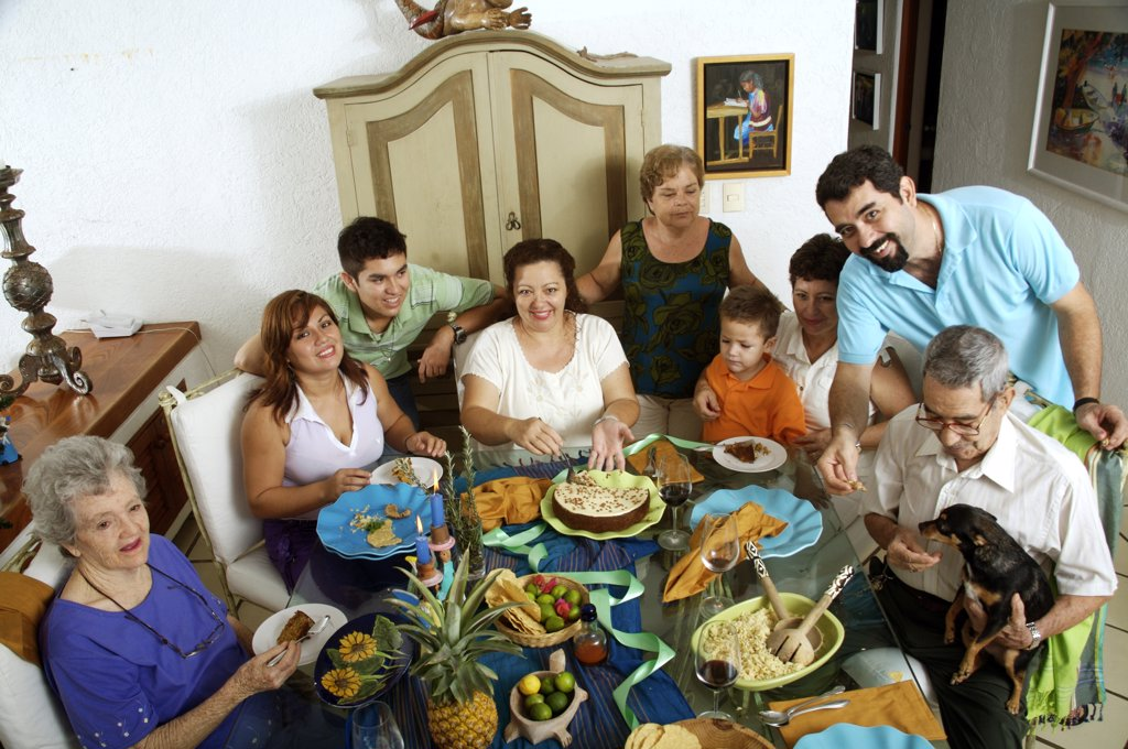High angle view of a family at the dining table : Stock Photo