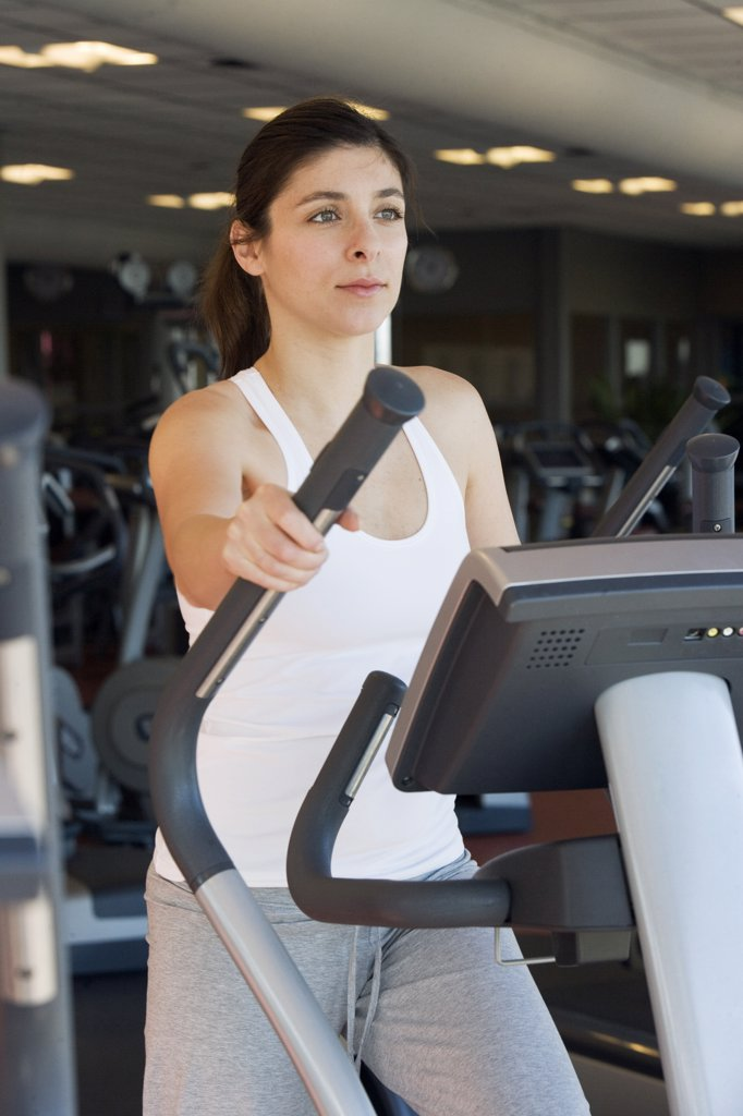 Stock Photo: 1574R-26312 Mid adult woman exercising