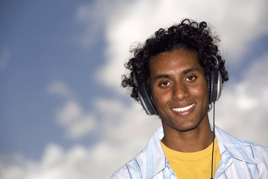 Stock Photo: 1574R-26522 Portrait of a young man wearing headphones