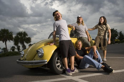 Friends by a car at the parking area : Stock Photo
