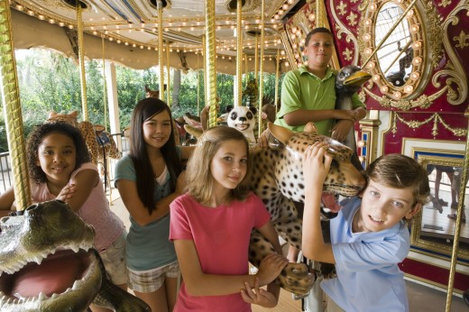 Portrait of teenagers standing in a carousel : Stock Photo
