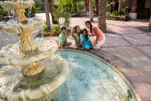 Stock Photo: 1574R-29346 Portrait of people sitting together by a water fountain