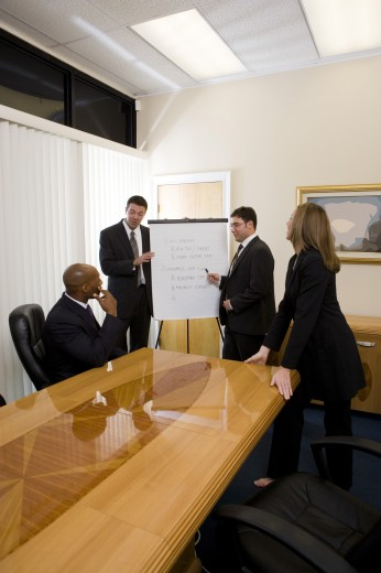 Stock Photo: 1574R-29508 Business people in full suit discussing in an office