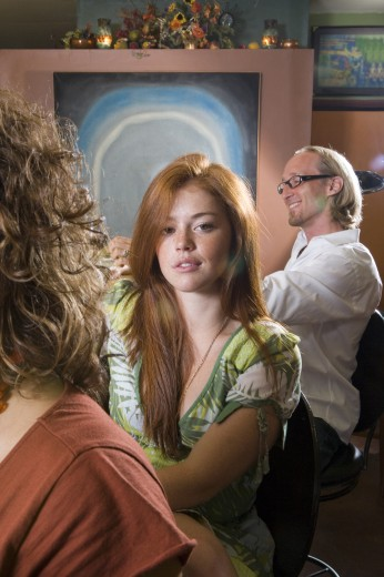Portrait of young woman with father behind : Stock Photo