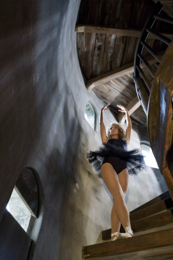 Low angle view of a ballet dancer practicing on a wooden staircase : Stock Photo