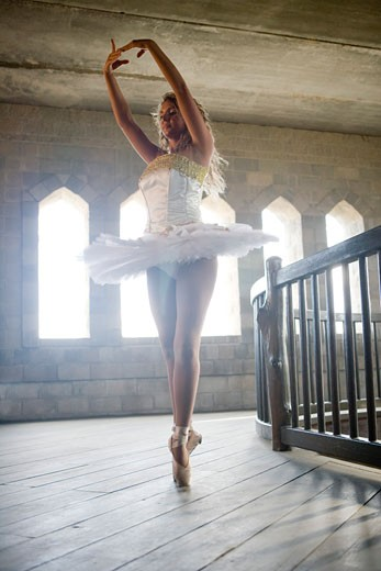Young woman practicing ballet dancing : Stock Photo