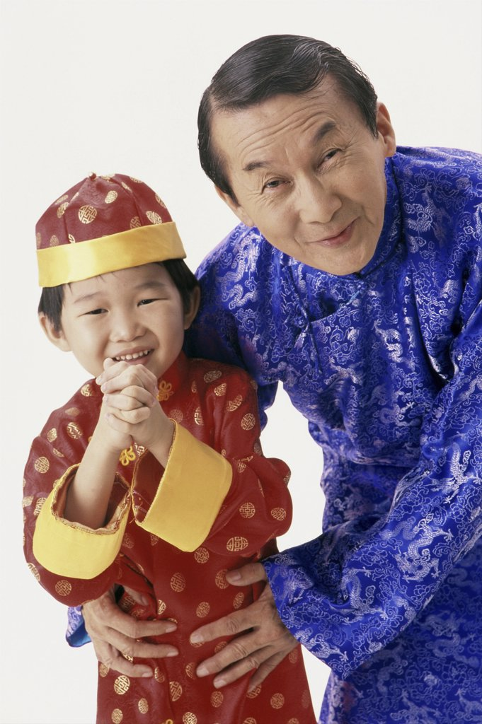 Portrait of a father and his son in traditional clothing : Stock Photo