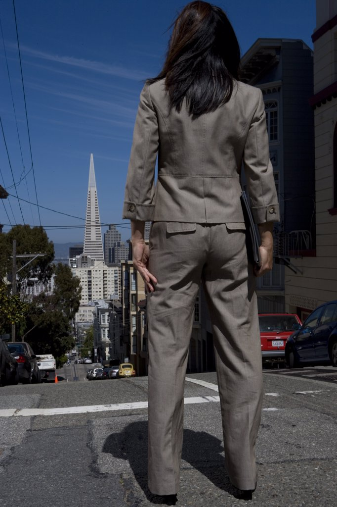 Rear view of a businesswoman standing on the road, San Francisco, California, USA : Stock Photo
