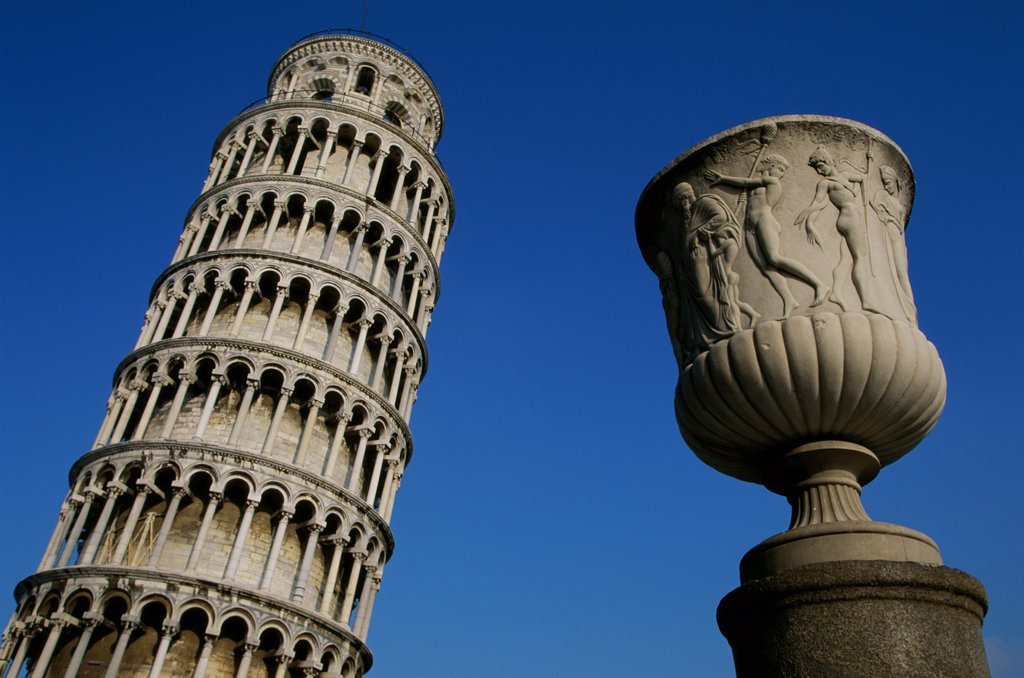 Low angle view of a decorative urn in front of a tower, Leaning Tower, Pisa, Italy : Stock Photo