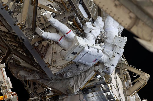 Stock Photo: 1574R-35291 Astronauts participate in extravehicular activity